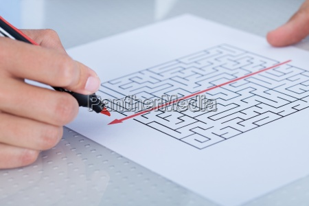 close up of hand solving puzzle