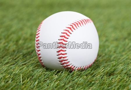 baseball on green pitch