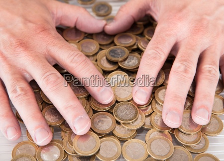 male hand on coins