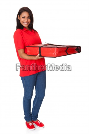 young woman with a whole pizza