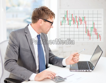 businessman with computer papers and calculator