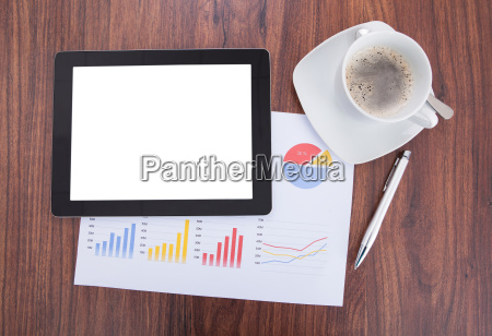 digital tablet document and coffee on