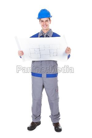 architect holding blueprint