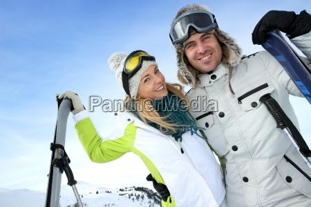 cheerful couple enjoying winter vacation