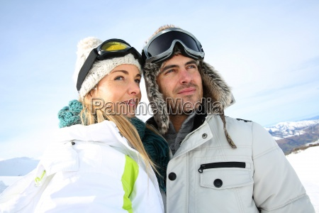 portrait of couple of skiers looking