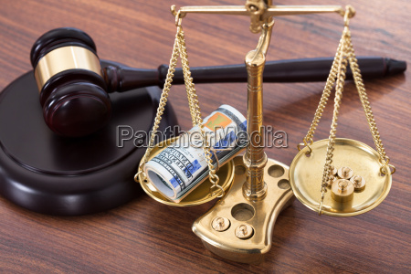 gavel and scales with money on