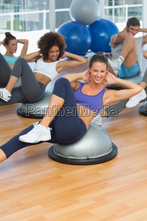 portrait of cheerful fitness class doing