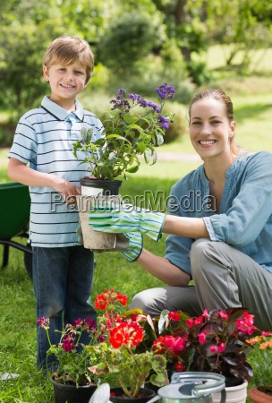 mother and son engaged in gardening