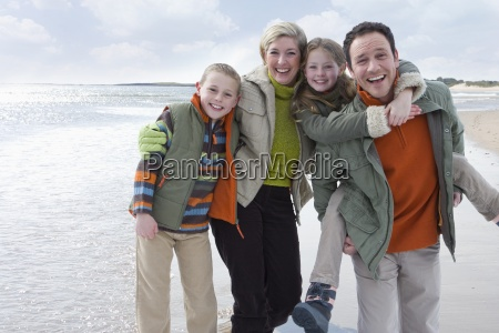 portrait of smiling family in warm