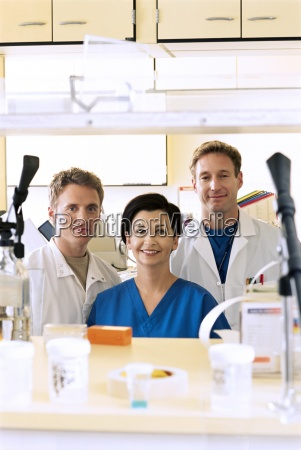 portrait of smiling pharmacists in hospital