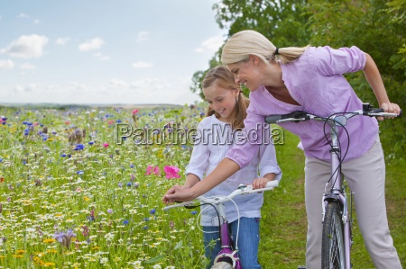 mother and daughter with bicycles looking