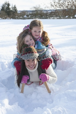 portrait of smiling mother and daughters