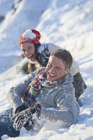 portrait of laughing couple in snow