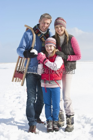 portrait of smiling parents and daughter