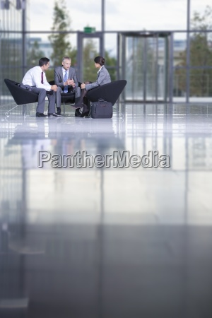 business people meeting in office lobby