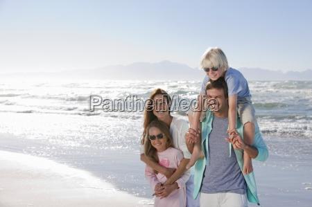 portrait of happy family on sunny