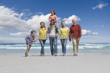 happy multi generation family walking on