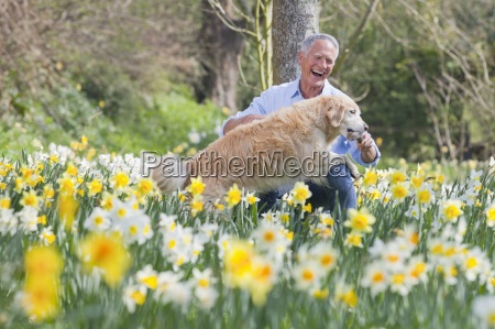 happy man playing with dog in