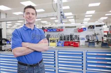 portrait of confident technician in hi