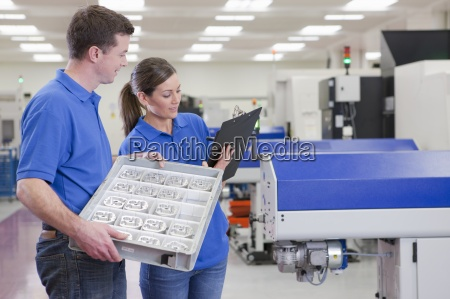 technicians with clipboard and aluminum products