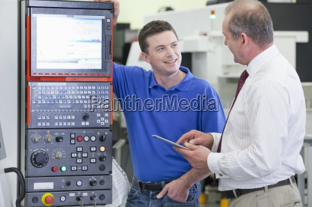 technician and businessman with digital tablet
