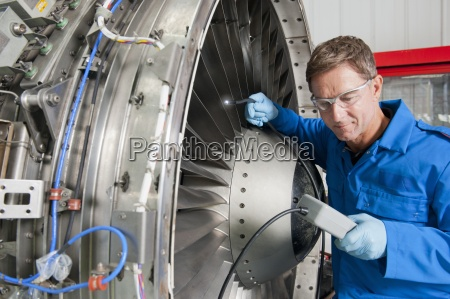 close up of engineer inspecting engine