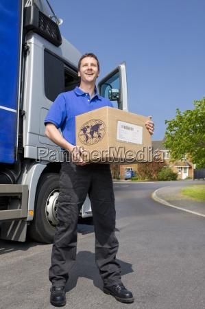 truck driver standing near semi truck
