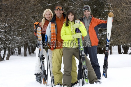 two young couples standing in snow