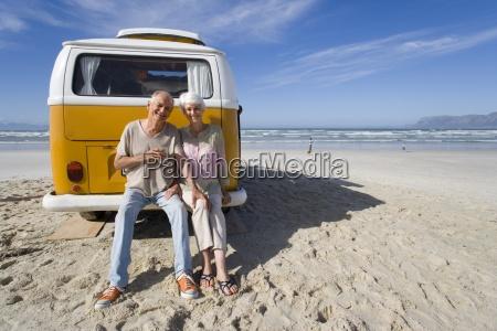 senior couple sitting on back of