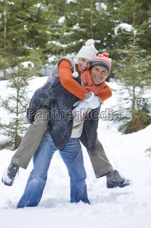 portrait of happy couple piggybacking in