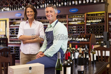 smiling business owners with digital tablet