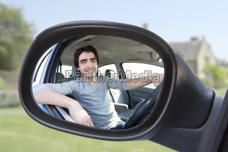 portrait through the rear view mirror
