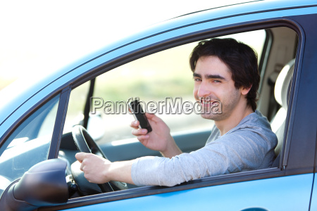 young man using his smartphone while