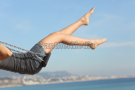 hair removed woman legs swinging on