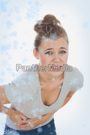 young woman suffering from stomach pain