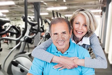 mature couple on pilates ball