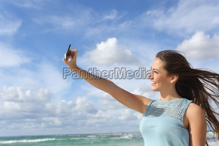 girl photographing a selfie with a