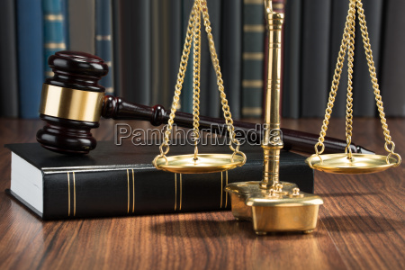 gavel on book with golden scale