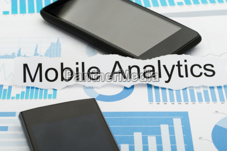 mobile phone and analytics text on