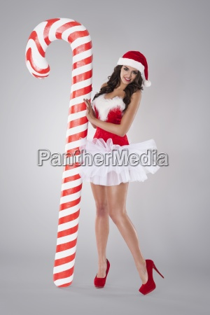 sexy santa claus with christmas candy