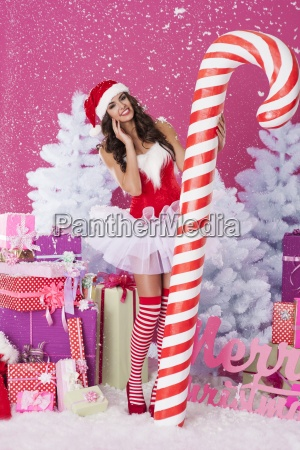 lovely woman with christmas candy cane
