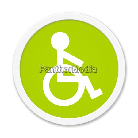 runder gruener button mit rollstuhl symbol
