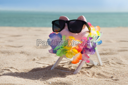piggy bank with sunglasses and garland