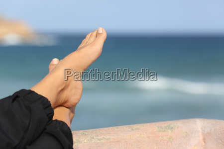 woman feet relaxing on an hotel