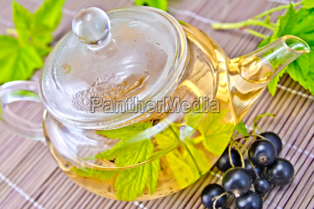 tea with black currants in glass