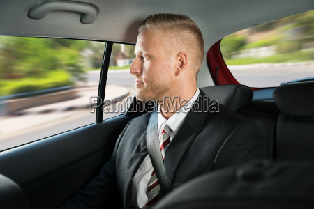 businessman travelling in car