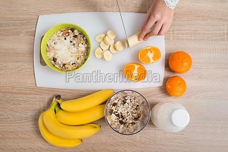 person hands preparing breakfast in kitchen