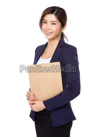 businesswoman holding the clipboard file
