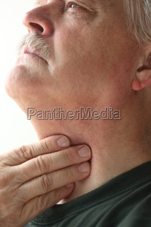 senior man with throat discomfort