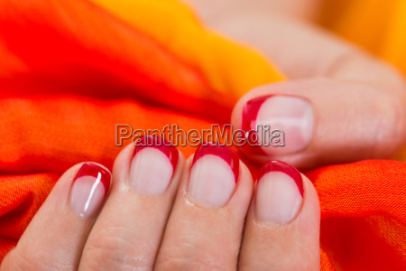 woman hands with nail varnish holding